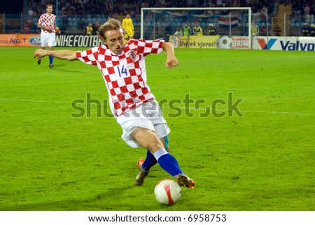being a soccer player of FC Arsenal - Luka Modric