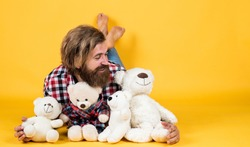 being in good mood. happy valentines day. cheerful bearded man hold teddy bear. male feel playful with bear. brutal mature hipster man play with toy. happy birthday. copy space.