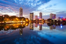 Beira lake and Colombo city skyline view at sunset. Beira lake is a lake in the center of the Colombo in Sri Lanka.