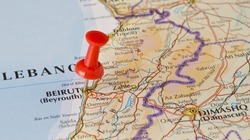 Beirut marked on map with red pushpin. Selective focus on the word Beirut and the pushpin. Pin is in an angle. Midground is sharp while foreground and background is blurry.