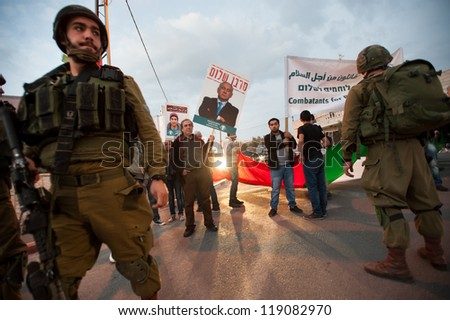 BEIT JALA, PALESTINIAN TERRITORY - NOVEMBER 17: Palestinian and Israeli activists confront Israeli soldiers in Beit Jala, West Bank, while protesting Israeli strikes on Gaza, November 17, 2012.