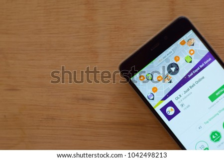 BEKASI, WEST JAVA, INDONESIA. MARCH 10, 2018 : OLX Buy & Sell Shopping Online dev application on Smartphone screen. OLX is a freeware web browser developed by OLX Indonesia #1042498213