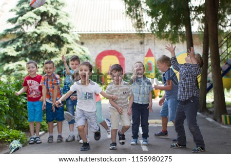Belarus, Gomel, May 29, 2018. The kindergarten is central. Open Day.A group of children in a kindergarten on the street playing fun. Happy preschoolers #1155980275