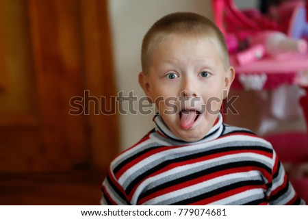 Belarus, the city of Gomel, on 14 December 2017. The children's garden is the fifth.The little boy showed his tongue. Frown and make faces #779074681