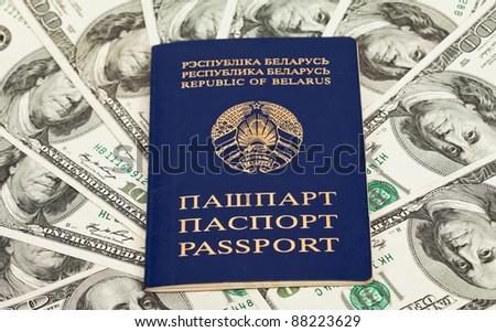 Belarusian passport on US dollars background - stock photo
