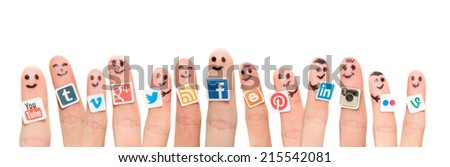 BELCHATOW POLAND AUGUST 31 2014 Happy group of finger smileys with popular social media logos printed on paper and stuck to the fingers