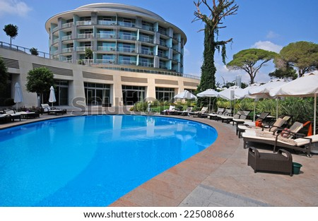 BELEK, TURKEY - AUGUST 10, 2008: Summer view of Calista Luxury Resort Hotel & Spa with swimming pool, sun beds and contemporary round building in Belek, Turkey.