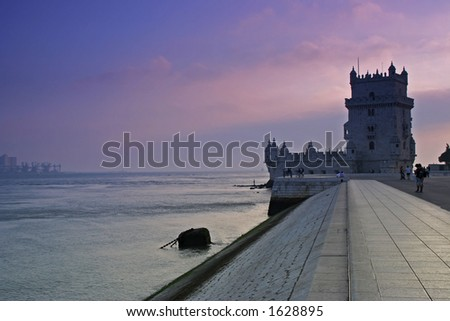 belem tower in lisbon at sunset - postcard from portugal