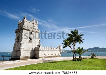 Belemsky turret on the river Tagus in Lisbon, Portugal, against palm trees