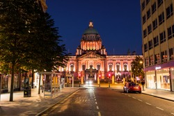 Belfast, UK. Nightlife with city hall in Belfast, UK the capital of Northern Ireland at night with dark blue sky