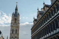 Belfort tower and City Hall of Ghent, Belgium. Medieval Belfry of Ghent, bell tower built on the medieval times, neo-gothic style tower near Saint Bavo Cathedral.
