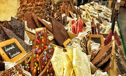Belgian chocolate in a traditional chocolate shop in Brussels, Belgium with white, black and colorful chocolate bars