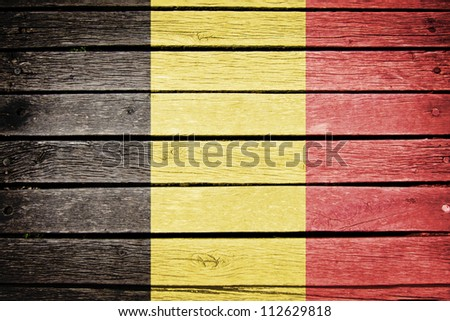 belgian flag painted on old wood plank background