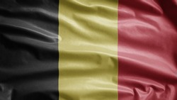 Belgian flag waving in the wind. Close up of Belgium banner blowing, soft and smooth silk. Cloth fabric texture ensign background. Use it for national day and country occasions concept.