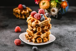 Belgian or french waffles for breakfast. Beautiful serve waffer cake with berries
