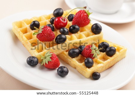 Belgian waffles with strawberry, cherry and blueberry
