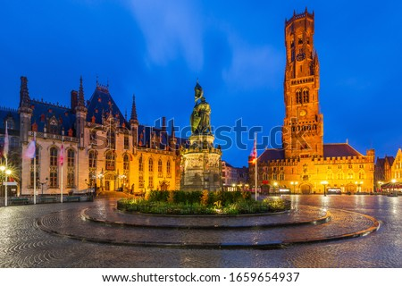 Belgium, Bruges, Grote Markt square with the Provinciaal Hof, Jan-Breydel-Monument and Belfry. Сток-фото ©