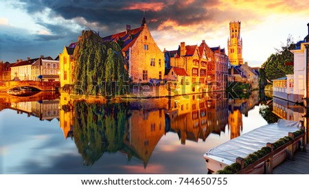 Belgium - Bruges,  Rozenhoedkaai with Perez de Malvenda house and Belfort van Brugge at sunset #744650755