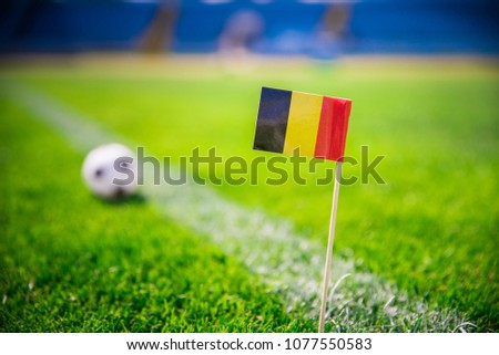 Belgium national Flag and football ball on green grass. Fans, support photo, edit space.   #1077550583