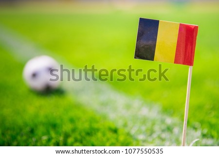 Belgium national Flag and football ball on green grass. Fans, support photo, edit space. Original wallpaper for World cup in Russia 2018. #1077550535