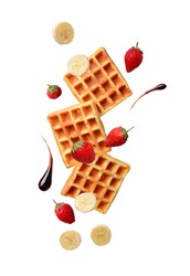 Belgium waffles with strawberries and banana. Food levitation. Isolated on white