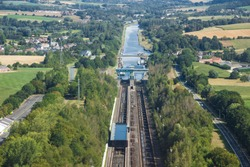 Belgium - Wallonia - Braine-le-Comte - The aerial panoramic view of downstream of Ronquieres inclined plane with one of its caissons mounted on rails full of water and surrounding fields and villages