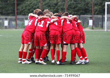 BELGOROD, RUSSIA - AUGUST 21: Unidentified boys embrace before football game on August, 21 2010 in Belgorod, Russia. The final of Chernozemje superiority, Football kinder team of 1996 year of birth.