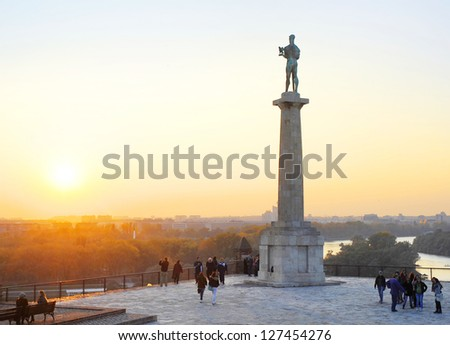 BELGRAD, SERBIA - OCTOBER 28:  Unidentified people at Statue of Victory on October 28, 2011 in  Belgrade, Serbia. Erected on 1928 to commemorate the Kingdom of Serbia war victories over Ottoman Empire