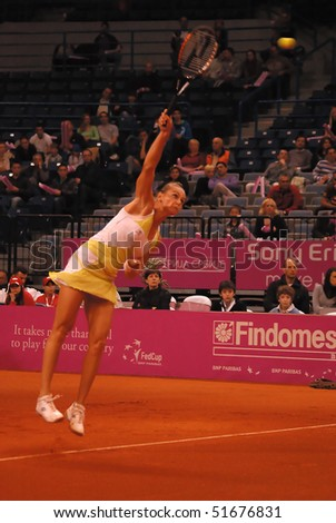 BELGRADE - APRIL 24: FED CUP SERBIA-SLOVAK REPUBLIC,Magdalena Rybarikova (SVK) serve a ball during a match against Jelena Jankovic (SRB), Jankovic won with 2:0. APRIL. 24, 2010 in Belgrade, Serbia