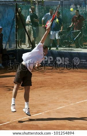 "BELGRADE-APRIL 29:""Serbia Open 2012"".Qualifications:Antonio Veic (CRO) vs Aldin Setkic (BIH),Player Aldin Setkic served a ball.Antonio Veic won 2:0.On April 29, 2012 in Belgrade, Serbia"