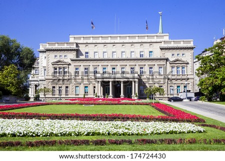Belgrade city hall with beautiful flowers and park in the front