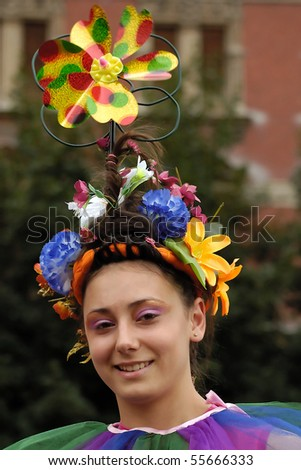 BELGRADE-JUNE 20 : BELGRADE BOAT CARNIVAL,Girl with beautiful flower,JUNE 20, 2010 in BELGRADE, SERBIA