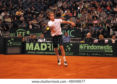 BELGRADE - MARCH 5: Amerikan Sam Querrey return a ball during a match against Serbian Novak Djokovic during DAVIS CUP SERBIA - USA, MARCH 5, 2010 in Belgrade, Serbia.Djokovic won 3-1