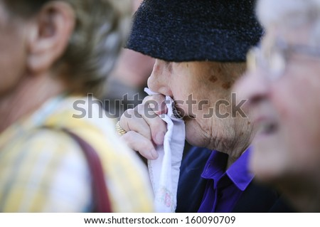BELGRADE - OCTOBER 26: Woman cries at funeral, Former Yugoslavia's first lady Jovanka Broz was laid to rest Saturday near the grave of her husband Josip Broz Tito in Belgrade, Serbia, October 26, 2013