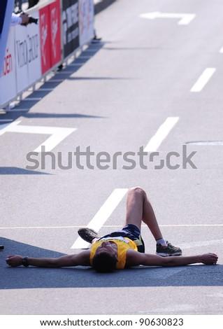 BELGRADE, SERBIA - APRIL 17: An unidentified runner lays down at the finish of the 24th Belgrade Marathon on April 17, 2011 in Belgrade, Serbia.
