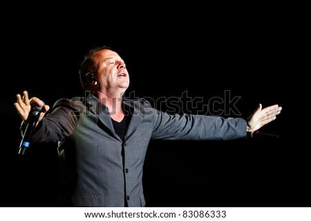 """BELGRADE, SERBIA - AUGUST 18 : Scottish pop rock music band """"SIMPLE MINDS"""" performs onstage at Belgrade BeerFest 2011 at """"Usce"""" August 18, 2011 in Belgrade, Serbia."""