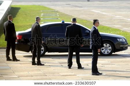 BELGRADE, SERBIA - CIRCA OCTOBER 2014: Security officers protects car with VIP person, circa October 2014 in Belgrade