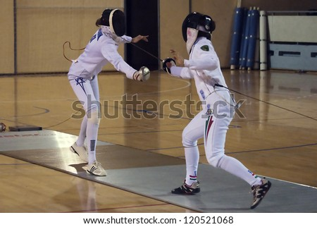 "BELGRADE,SERBIA-DECEMBER1:Fencer Marinuk Avital(ISR) fight against Mihaly Kata(HUN) on the ""57. International Trophy of Belgrade"" Mihaly won.December1,2012 in Belgrade,Serbia"