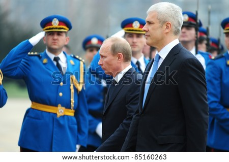 BELGRADE, SERBIA - MARCH 23: Serbian President B.Tadic (R) and Russian Prime Minister V.Putin review a guard of honor of the Serbian army in Belgrade, Serbia, March 23, 2011