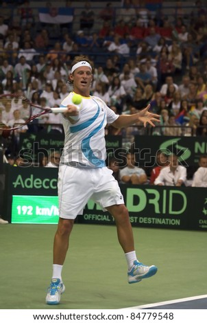 BELGRADE,SERBIA-SEPT 16:Player D.Nalbandian(ARG) returns a ball against V.Troicki(SRB) during semifinal Davis Cup match Serbia-Argentina.Nalbandian won 3:1,on September 16,2011 in Belgrade,Serbia