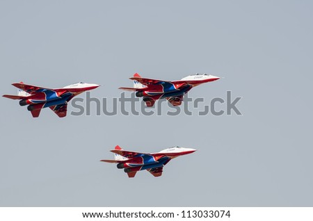 BELGRADE, SERBIA - SEPTEMBER 2: Acrobatic aircrafts Mig-29 on the Airshow Batajnica 2012 in Belgrade, Serbia on September 2, 2012.