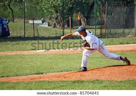 BELGRADE SERBIA - SEPTEMBER 24: Unidentified player in action on the baseball match Belgrade (white) vs. Vojvode (blue) on the Ada field on September 24, 2011 in Belgrade, Serbia.
