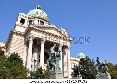 BELGRADE, SERBIA - SEPTEMBER 23, 2018.View of the Parliament of the Republic of Serbia with two sculptures at the entrance at the Nikola Pasic Square in Belgrade. #1191049132