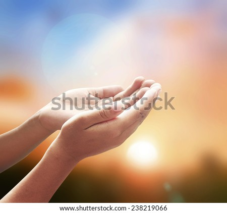 Believe and devotion concept: Christian open two empty hands with palms up on autumn sunrise background. #238219066