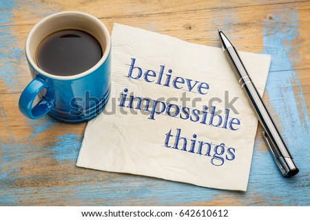 Believe impossible things - inspirational handwriting on a napkin with a cup of espresso coffee #642610612