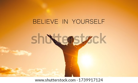 Believe in yourself concept. silhouette of a man with arms raised to the sky Foto d'archivio ©