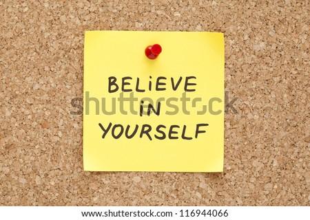 Believe In Yourself, written on an yellow sticky note on a cork bulletin board
