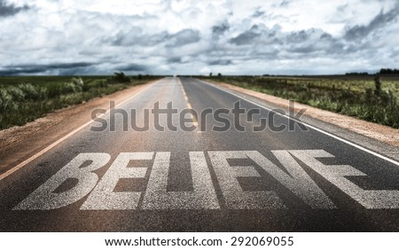 Believe written on rural road
