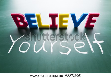 Believe yourself, Colorful words on blackboard.