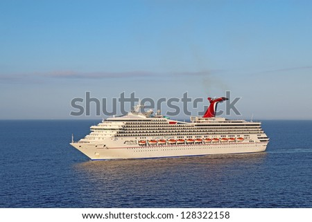 BELIZE CITY - DECEMBER 26: The cruise ship Carnival Triumph on December 26, 2011. An engine fire in February 2013 caused the ship to lose power and it was towed into port after being adrift for days.